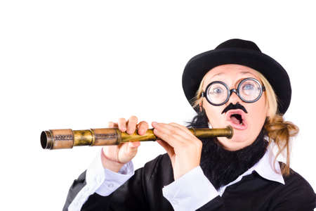 black rimmed: Strange woman in disguise wearing black bowler hat , fake beard and mustache , wide rimmed glasses  holding extended antique telescope Stock Photo