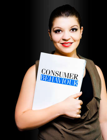 strategist: Friendly woman clutching a folder entitled Consumer Behaviour conducting a consumer survey as she tries to pinpoint and track trends in consumer behaviour