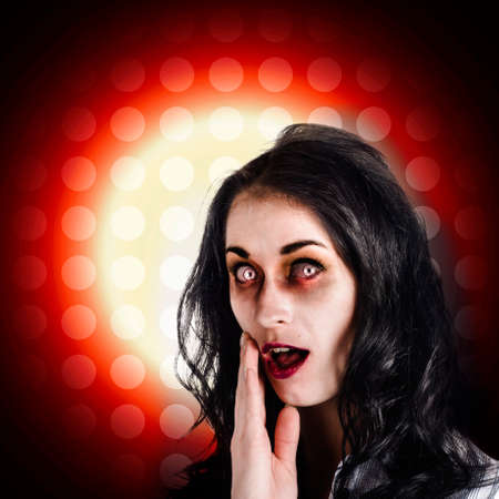 reanimated: Dark portrait of a zombie female business person covering mouth in shock horror