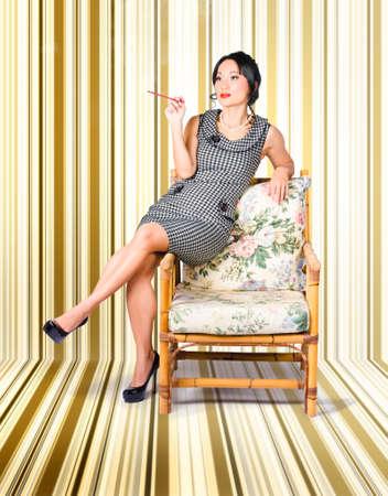 sexy girl smoking: Vintage fashion portrait of elegant woman smoking on chair inside a retro striped interior Stock Photo