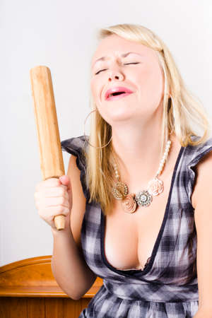 depiction: Unhappy Housewife Crying In The Kitchen With Broken Rolling Pin In A Depiction Of A Cooking Blunder