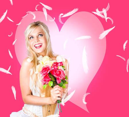 struck: Love struck female beauty dancing in a raining feather romance. Pink heart design background
