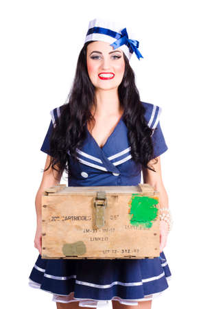 seafaring: Vintage seafaring lady with big smile holding nautical supplies in ammunition box. Sailor pin up