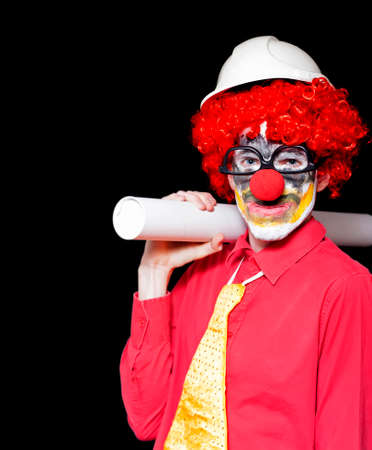 dodgy: Engineering Clown Holding Rolled Up Blueprint In A Depiction Of Unstable And Dodgy Building Practices