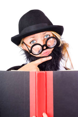 disguised: Thoughtful woman disguised as businessman with beard, open book in foreground
