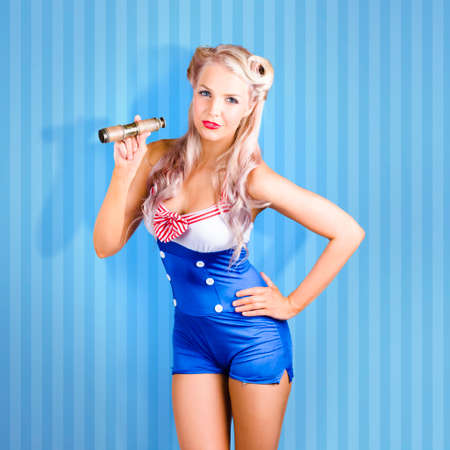 nude young girl: Retro style pinup sailor girl holding contracted monocular on blue maritime stripe background