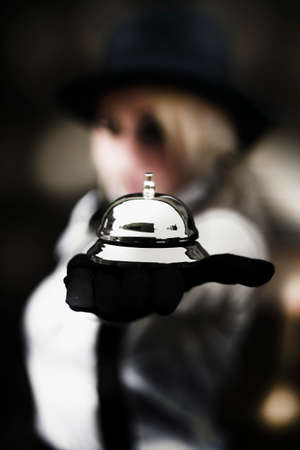 business service: A Butler Serving Up A Silver Service Bell Reaches Out To Help Customers In Successful Customer Service