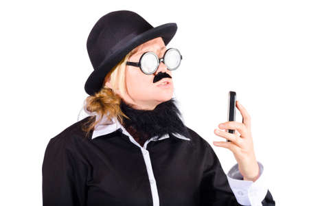 mobile telephone: Nerdy woman disguised as businessman in hat with slim mobile telephone, white background Stock Photo