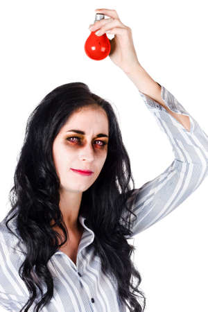ghoulish: Zombie woman holding red light bulb above her head as red alert warning on white background