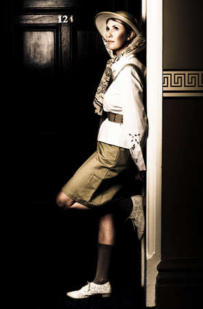 intrepid: Daydreaming Female Explorer In Safari Clothing Waiting Outside A Hotel Room Just Before Her Journey Into The Savannah, In A Travel Adventure Awaits Conceptual