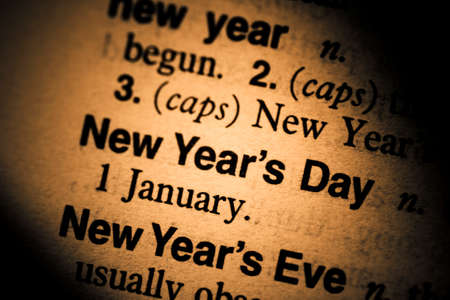 new years day: Macro Low DOF Focus On The Words New Years Day In A Dictionary Stock Photo