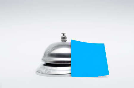silver service: Silver Service Hotel Bell With Empty Blue Message And Room For Copy