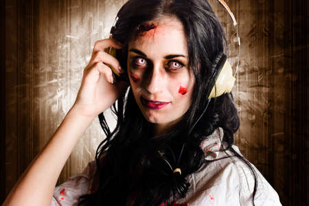 death metal: Alternative zombie girl listening to melodic death metal with earphones when rocking out to the sound of the underground music scene