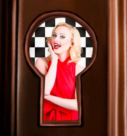 view through door: Stylish surprised women portrait. Secret pin up view through closed door key hole Stock Photo