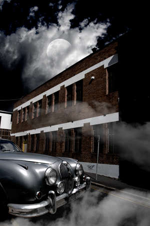 dimly: An Old Antique Car Parked Next To A Two-Story Building On Moonlit Night