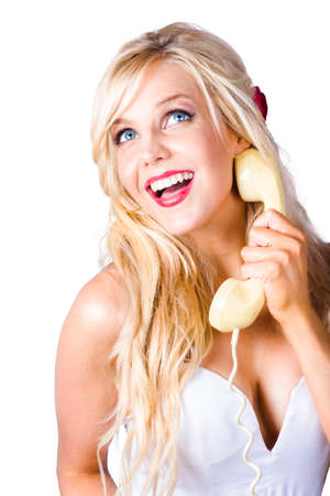 chitchat: Happy young blond woman laughing with retro sixties telephone reciever in hand, Over white background