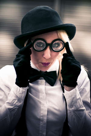 lighthearted: Funny Woman Puts On A Pair Of Silly Looking Glasses With Fun Lighthearted Expression Stock Photo