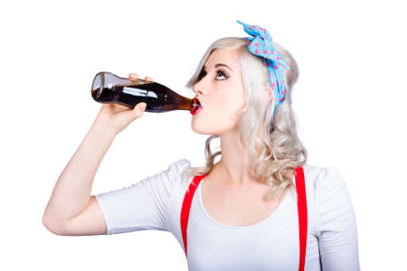 sodas: Vintage image of fifties pin-up promo woman drinking soft drink from glass cola bottle Stock Photo