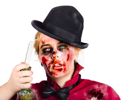 flickering: Portrait of frightened young zombie in bowler hat covered in blood and holding flickering candle.