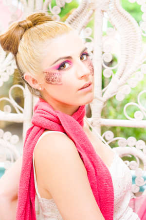 poised: Poised Glamour Model Girl In 20s With Blond Hair In A Bow Wearing A Pink Scarf In A Fashion Glamour Cosmetics Or Makeup Picture