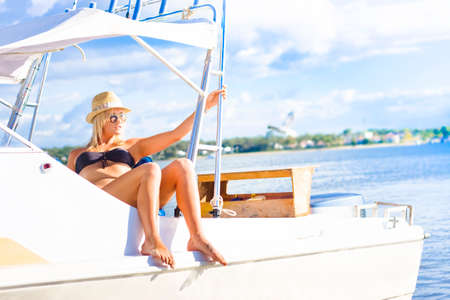 beach cruiser: Image Of Luxury And Marine Transportation, A Woman With Blonde Hair Sitting In The Cabin Of A Speed Boat Cursing On The Sea, Horizontal Image With Copy Space