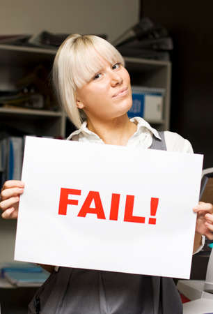 fails: Fail To You Says The Sign An Corporate Woman Holds Up In An Office Print Room