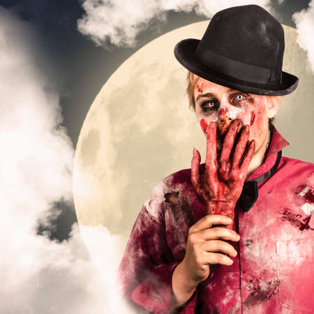 grisly: Ghastly ghoul standing in clouds of fog during a full moon halloween night. Moonlight scare Stock Photo