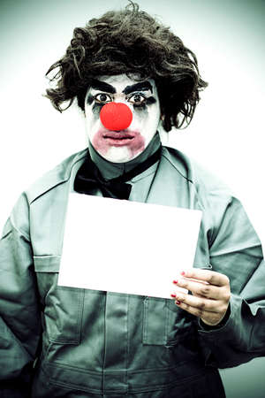 rueful: A Sign Of Unhappiness With A Sad Clown Holding A Blank Sign