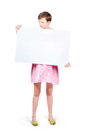 this: Woman looking down to read your text on blank advertising board on white copyspace