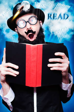 eccentric: Eccentric Wizard In Glasses And Hat Reading Fiction Novel While Learning About The Endless Possibilities Of A Inspired Imagination