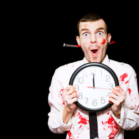 bloodied: Creepy Halloween Ghoul In Blood Stained Business Shirt And Tie Holding Clock Set To Midnight In A All Hallows Eve Specials Concept On Black Background