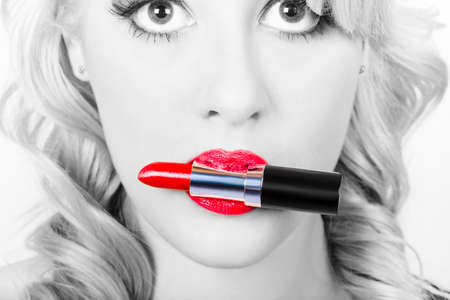 black and red: Closeup vintage black and white beauty portrait on the bright red lips of a fashion model girl promoting lipstick make up. Vogue style cosmetics Stock Photo