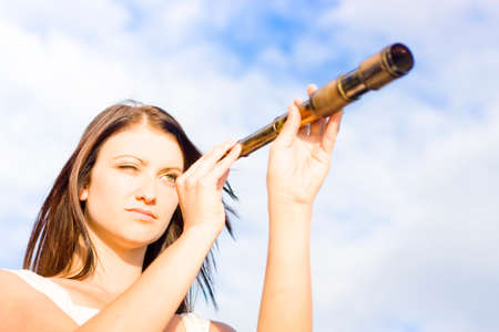 olden day: Portrait Of Young Woman With Telescope In An Image Depiction Of Hope Opportunity And Future Outlook, Copyspace In The Blue Cloudy Sky Background