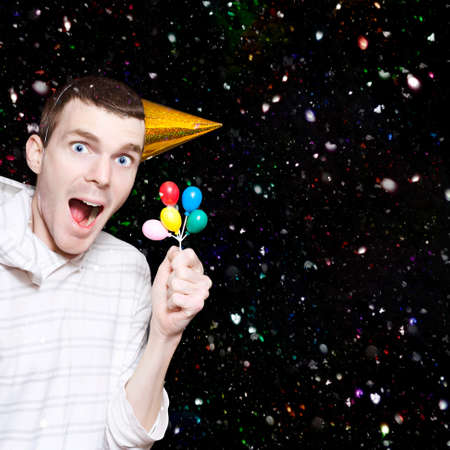 merrymaking: Happy Boy With Look Of Excitement Wearing Party Hat Celebrating His Birthday With Balloons And Confetti
