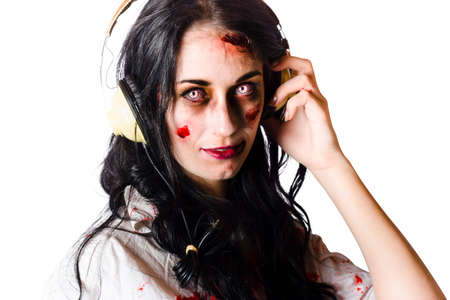 hardcore: Young zombie woman with wounded blood stained face wearing headphones at halloween disco while rocking out to metal and hardcore music white background