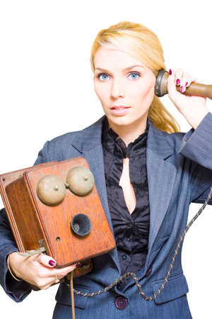 telephonic: Professional And Corporate Blond Female Business Phone Operator Holding A Retro Telephone In Past Era Image Of Communication And Old Fashioned Technology Stock Photo