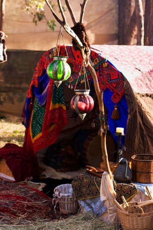 nomad: A Gypsy Tent Draped In Fabric With Lanterns and Baskets At The Entrance Stock Photo