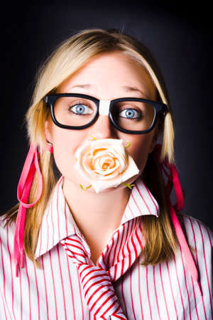 lovelorn: Silenced Nerd With Expression Of Admiration Holding Cream Rose Flower Bud In Mouth When Professing Untold Love