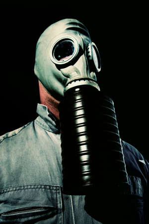 onslaught: A Masked Soldier Stares Fearlessly Into Darkness, Fully Prepared For The Hazardous Gas Onslaught