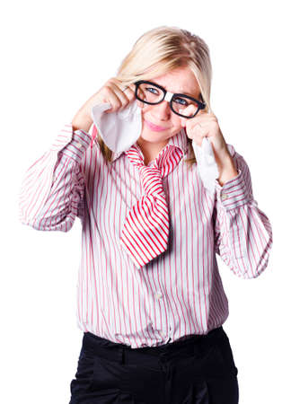 handkerchiefs: Crying young blond business woman wiping tears from eyes with handkerchiefs, white background