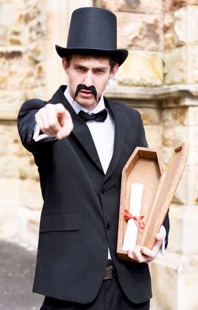 spiritualist: Vintage Man Points Directly At You While Holding A Open Small Wooden Coffin With A Letter Inside As This Is A Message From The Grave
