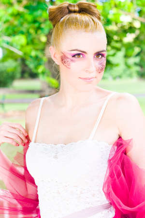 cheekbones: Dance Concept With The Face Of A Gorgeous And Attractive Blonde Ballet Dancer Woman In Magenta Leotard Standing At A Outdoor Forest Location