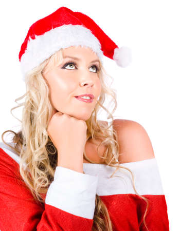 mrs santa: Beautiful Mrs Santa Clause Woman In Thought While Looking Up To Empty Copy Space On White Background Stock Photo