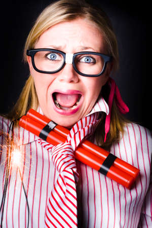 traumatised: Crazy business woman screaming with lit bomb under striped tie while a deadline of explosive stress looms