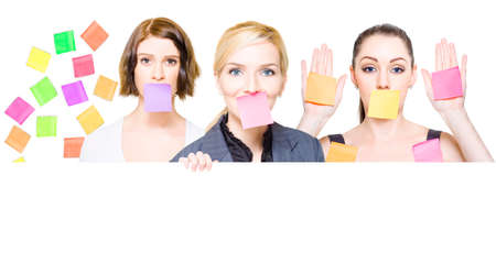 resistence: Isolated busy female business people with sticky notes over their mouths and on the office wall with room for a cute comment or silly message, white background