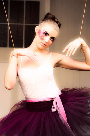 tied girl: Marionette Doll Wearing Tutu Or Leotard Hanging Or Suspended On Strings And Cords In A Artistic Representation Of Management Dominance Control And Power