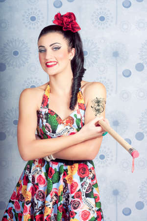 arm tattoo: Beautiful day Of The dead girl drawing tattoo design on arm. Tattoo artist Stock Photo