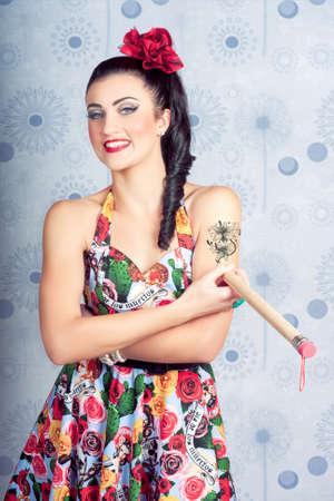 tattoo girl: Beautiful day Of The dead girl drawing tattoo design on arm. Tattoo artist Stock Photo