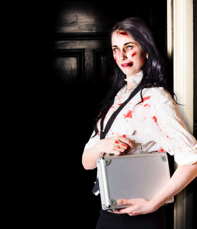 malevolent: Dead female zombie worker holding briefcase while walking in office space. Dead set concept. Stock Photo