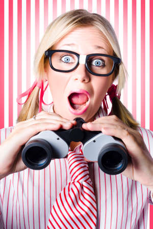 imminent: Excited Business Woman Holding Binoculars When Searching For Market Opportunities In A Coming Soon So Watch This Space Concept Stock Photo